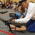 CROSSBOW CLASS - Freddie Jones, a longtime Rogers educator who retired last year, shows Shelby Seal,...