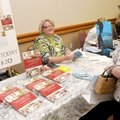 AUTHORS SHOWCASE - Jo Ann Snapp, right, an author, talks Friday with Frankie Carlin Meyer about her ...