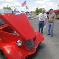 Jim Stokes, left, shows off his 1934 Ford three-window coupe he built to Ed Wieder of Fayetteville o...