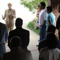 PRAYER VIGIL - Bentonville attorney Susie L. Hoeller, left, speaks to a group assembled Thursday at ...