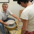 VESSEL OF CREATION - Jim Young forms a piece of clay into a vessel Friday during a demonstration at ...