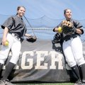 Bentonville pitcher Kaisha Arnold, left, and catcher Macey Brake are both first-year starters for th...