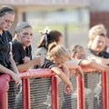 Bentonville's Meghan Green, left, and her teammates react to a seventh-inning, two-run home run by B...