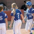Bryant's Cassidy Wilson, right, is congratulated at the plate after hitting a two run home run durin...