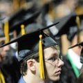 Austin Branam listens Saturday to a speaker during the Bentonville High School Class of 2010 commenc...