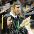 Presley Covington listens Saturday to a speaker during the Bentonville High School Class of 2010 com...