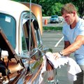 Eric Shaffer, of Fayetteville, shines up his father's all original 1953 Chevrolet Bel Air at the Bik...