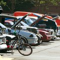 Visitors look over a variety of cars Saturday lined up in the parking lot of the Northwest Arkansas ...