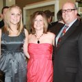 Heart Gala supporters Steve and Lori Collins, from right, enjoy the VIP reception with daughter Ambe...