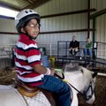 Anthony Ramirez sits on Milo, a horse at Horses for Healing, as he answers question from judges whil...