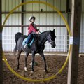 Zackery Simek rides Bandit through the obstacle course during the Horses for Healing Special Olympic...