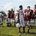 Springdale High football players Pat Morse, from left, Kyle Camp, and Max Montgomery talk on the sid...