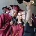 Kristen Novotny, right, takes a photo of students Jesús Paredes, left, and Jahzeel Olvera on Saturda...