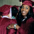 Jewel Tabron looks up Saturday after hugging a friend while waiting in line before the start of the ...