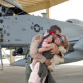 Lt. Wade Hendrickson of Fort Smith hugs his wife, Malea, and his 5-month-old daughter Rylin Saturday...