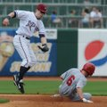 Northwest Arkansas' Chris McConnell, left, tries to tag Arkansas' Andrew Romine as he steals second ...
