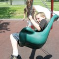 Daniel Scott, 8, gets a dizzying spin in a swing powered by his sister Cheyanne Scott, 12, at Gentry...