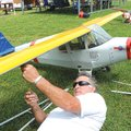 Jerry Shrum of Springdale works on his one-third scale J-4 Piper Cub during the Ozark Flyers' second...