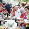 Members of the Student Ministry, left, serve supper Sunday evening during the Fire in the Street blo...