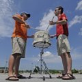 Brad Stowe, left, and Matt Hoffman, both of Fayetteville, play a snare drum Monday in a parking lot ...