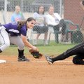 Fayetteville third baseman Rebecca Cantu tags out Bentonville's Alex Cooper during a May 11 game in ...