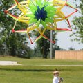 Ian Litchford, 4, runs to fly his kite Monday after his dad, Brian Litchford, not pictured, releases...