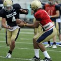 Shiloh Christian quarterback Kiehl Frazier hands off to running back Garrett Harper during practice ...