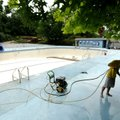 Ryan Layes, assistant pool manager for Fayetteville's Parks and Recreation Division, uses a pressure...