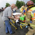 Stephen Varner talks to Sarah Beth Champagne as she is moved to a waiting ambulance Tuesday after be...