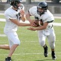 Bentonville running back Alberto Hernandez takes the handoff from quarterback Pearson Gean during sp...