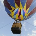 Tanner Anderson, left, and James Higdon get a ride Wednesday in a hot air balloon piloted by Darrel ...