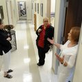 Brenda Zedlitz, director of EOA Head Start, from right, talks Wednesday with Misti McCoy, director o...