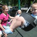 DOUBLE THE FUN - Daniel Sanders, 4, swings Thursday at Dave Peel Park in Bentonville with his mom, ...