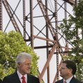 Former President Bill Clinton, left, speaks with U.S. Assistant Secretary of Commerce John Fernandez...