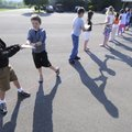 BOOK BRIGADE - Elkins Elementary School third- and fourth-graders pass books along a line Thursday ...