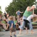 SUMMER CONCERT - Maggie Beason of Fayetteville and her 7-year-old daughter, Lola Beason, dance Thurs...