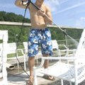 POOL PREP - Matt Fryauf of Rogers washes chairs Thursday at the Lake Atalanta Park swimming pool ne...
