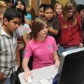 PEEK AT THE FUTURE - Students from Eastside Elementary School in Rogers gather Thursday around Peyt...