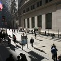 In this file photo taken March 9, 2010, people walk on Wall Street, in New York. Stocks appear set t...