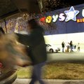 In this file photo from November 27, 2009, a shopper loads purchases into their vehicle after pre-da...