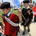 Matias Flowers, 5, left, and older brother Lucas sport traditional Argentinian gauchos while leadin...