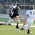 Bentonville's Drew Edwards, left, attempts to turn the corner against Corbin Copeland during the Ti...