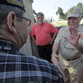 Don Tyson, right, shakes hands Friday with veteran Raymond Jones of Fayetteville at Fayetteville Nat...