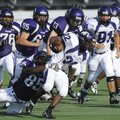 Fayetteville senior Devin Bowers, left, tackles junior Austin Bramwell near the line of scrimmage d...