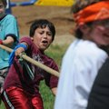 Nicandro Cabajal, 8, pulls a rope Friday during a tug-of-war game at Northside Elementary School in...