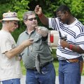 CATCH AND RELEASE - Ron Duncan, middle, holds up a fish caught May 21 by Dekendrick Jett, 14, right,...