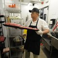 Jim Moser of Bentonville works Wednesday at the meat department of the Walmart Neighborhood Market ...