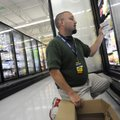 Walmart associate Chris Loucks stocks Great Value frozen food items May 4 at the Walmart Neighborho...