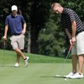 Drew Stewart, right, putts on No. 6 as Dusty Gourley watches Saturday during the Ellis Bogan Memoria...
