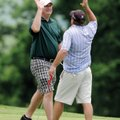Brett Murphy, left, slaps hands with Adam Russell after Russell sank a par putt on No. 9 during the ...